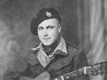 A wartime Fred J Taylor with his guitar